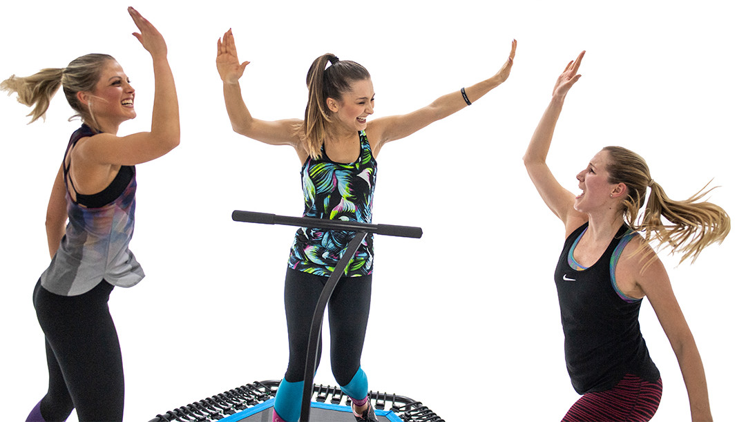 High Five Women on trampolines - jumping fitness